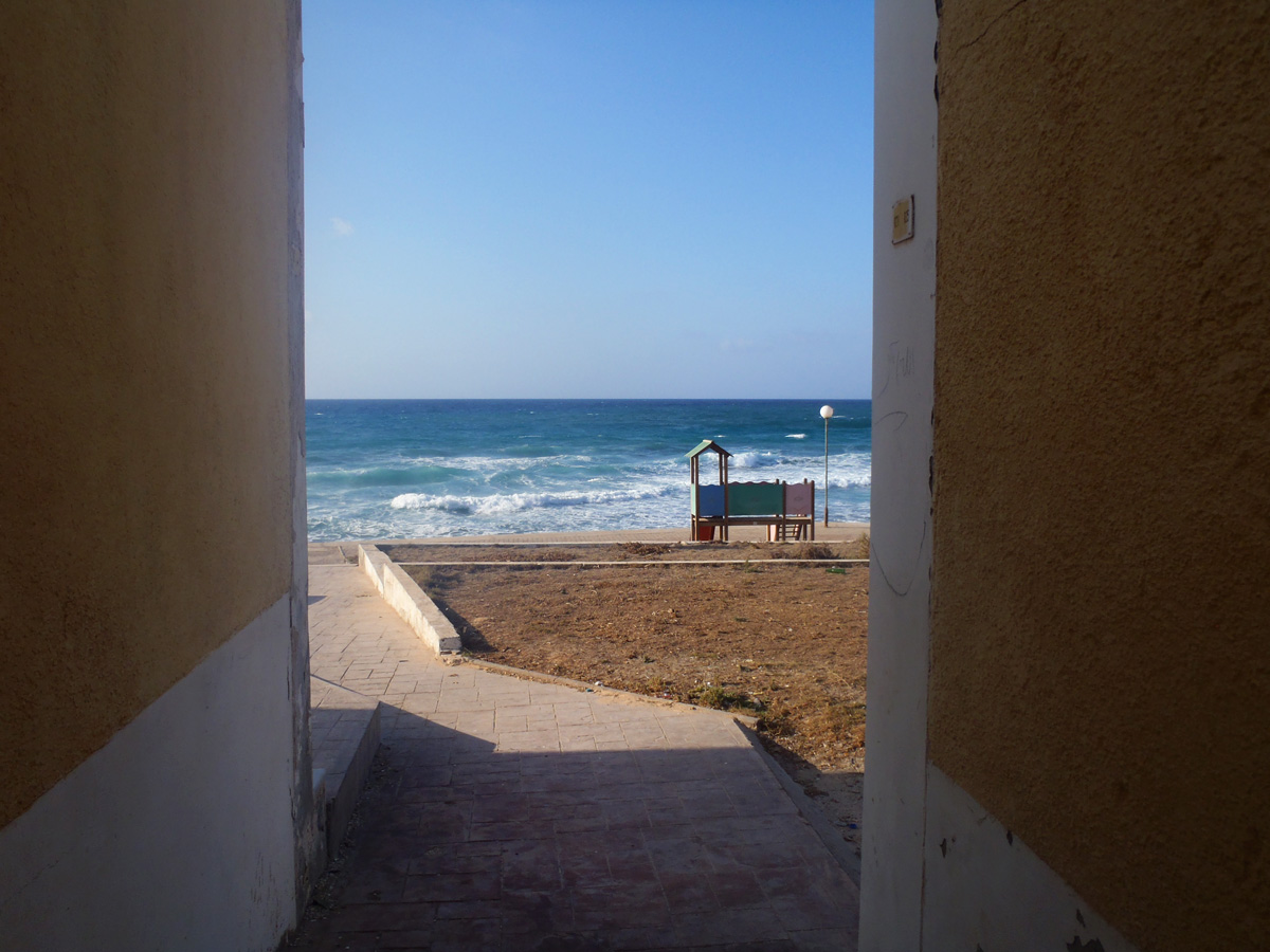 A view of the surf between two bungalows in Janzour Tourist Village in Tripoli.