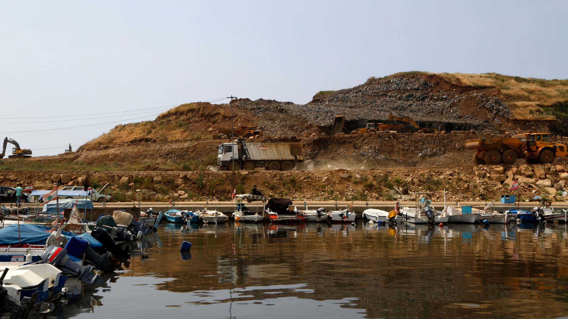 A truck hauls waste at the Bourj Hammoud landfill site. Untreated waste is being dumped into the sea as a part of the land reclamation project.